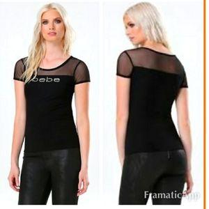 NWT Bebe Rhinestone Black Top with shirt sleeves.M